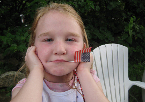 Rockport: Molly Ambrose plugs her ears as the fire trucks go by during Rockport's annual Forth of July parade Saturday evening. Gail McCarthy/Gloucester Daily Times