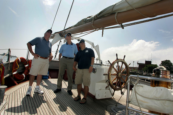 Gloucester: Binh Le, right, captian of the sailing research vessel Corwith Cramer, a 134Õ steel brigantine owned by the Sea Association (SEA) of Woods Hole, talks with Doug Scott, left, and David Morris about climbing the steep rigging while the vessel was docked at the Maritime Heritage Center Saturday. Mary Muckenhoupt/Gloucester Daily Times