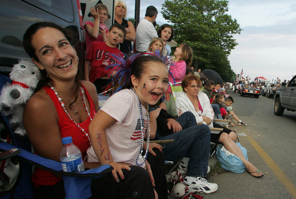 Gloucester: Christina Polsonetti, 5, of Gloucester spots Winnie the Pooh walking down Stacy Boulevard while sitting with her mom Jennifer during the Horribles Parade Friday evening.  Mary Muckenhoupt/Gloucester Daily Times