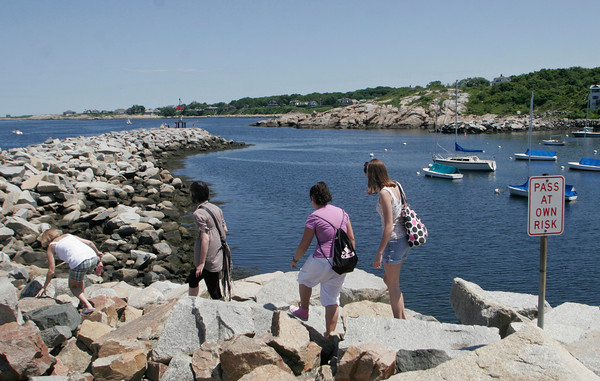 From left to right: Ann Vasil, Uxue 17, Marta 17, and Megan Vasil 14 climb the rocks at the end of Bearskin Neck yesterday. Marta and Uxue are foreign exchange students from Pamplona, Spain that are staying with the Vasil family for one month. Photo by Maria Uminski/Gloucester Daily Times