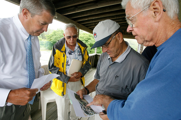Rockport: Patrick Fortin, left, Selectman Sandy Jacques, Selectman Andrew Heinze, and Ward Talbot review a map of Long Beach that shows an area of town land that they would like to open for parking. Photo by Kate Glass/Gloucester Daily Times Thursday, July 23, 2009