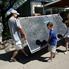 Manchester: Don Twonbly of Rockport and his children Calvin, 8, and Emma, 9, Carry out one of the schools black boards they got at the Manchester Essex High School yard sale Saturday morning. The school was selling old chairs, desks, filing cabinets and more in exchange for donations to the school's environmental group, the Green Team. Twombly took this and one other blackboard for his kids' play room. Mary Muckenhoupt/Gloucester Daily Times