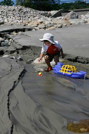 "Rockport: Carter Stevens, 2, of Cooperstown, NY sends a boat and shovel down the ""river"" at Back Beach in Rockport on Wednesday afternoon. His family, which has been vacationing in Rockport every summer for several years, is in town for one week. Photo by Kate Glass/Gloucester Daily Times Wednesday, July 15, 2009"
