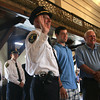 Gloucester: Interim Police Chief Michael Lane smiles as he is sworn in during the Public Safety Badge Ceremony at Gloucester City Hall last night. Standing with Lane are his son, Jeff, and father, Leland. Photo by Kate Glass/Gloucester Daily Times Thursday, July 30, 2009