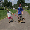 Essex: Alec Powers, 9, and his brother Ryan, 13, walk their dog on Conomo Point Saturday afternoon.  Alec and Ryan planned on spending the day at the beach. Mary Muckenhoupt/Gloucester Daily Times