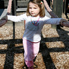Essex: Maddie Marron, 3, of Essex carefully crosses the tightrope at the Essex Elementary School playground Wednesday afternoon. Photo by Kate Glass/Gloucester Daily Times Wednesday, July 22, 2009