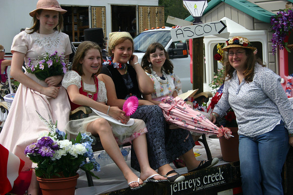 "Manchester: From left, Addie Pates, 12, Elizabeth Ranger, 11, Emily Jaworski, 11, Julia Gaswell, 12, and Lynn Jaworski promote the Summer Stage performance of ""My Fair Lady"" on a float in the Manchester 4th of July Parade Saturday morning. Silvie Lockerova/Gloucester Daily Times"