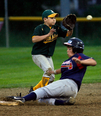 Gloucester: Sal Costanzo reaches for the ball as Sam Kirk steals second base during the Gloucester Little League Majors B World Series game between the Athletics and Braves. The Braves won 2-1. Photo by Kate Glass/Gloucester Daily Times Thursday, Julyl 23, 2009