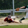 Gloucester: Gloucester's Kevin Hurd sneaks behind Billerica's Connor Elmore to score during the second inning of Gloucester's Senior Little League game against Billerica at Nate Ross Field last night. Photo by Kate Glass/Gloucester Daily Times Monday, July 20, 2009