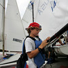 Gloucester: Griffin Webber, 11, ties on the sail to his boat as he gets ready for the 108th annual Squam Day sailing races at Annisquam Yaught Club Friday morning.  Mary Muckenhoupt/Gloucester Daily Times