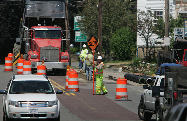 Essex: A flagger directs traffic on Route 133 in Essex Thursday morning. Mary Muckenhoupt/Gloucester Daily Times