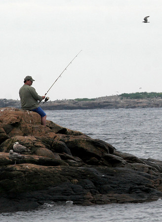 Rockport: Michael Hale of Barnet, Vermont fishes along Pebble Beach in Rockport yesterday. Hale and his wife are visiting the area for one week. Photo by Kate Glass/Gloucester Daily Times Tuesday, July 21, 2009