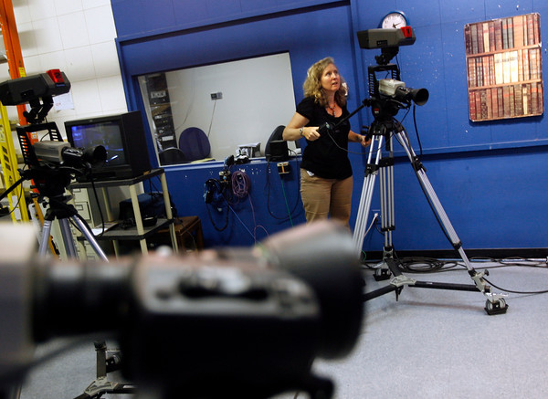 Gloucester: Lisa Smith of Cape Ann TV repositions a camera in their studio to set up a shot. The station recently won an award for providing community and education programming. Photo by Kate Glass/Gloucester Daily Times Tuesday, July 21, 2009