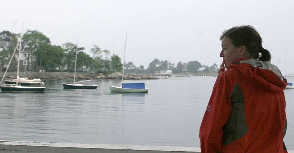 Susan Haering listens for the results of the MSA Opti Green Fleet Regatta at Tuck's point yesterday. Her son was a participant in the race. Photo by Maria Uminski/ Gloucester Daily Times