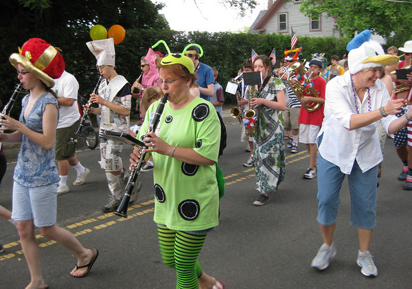 Rockport: Melinda Picardo plays the clarinet dressed as a green bug in George Ramsden's Rockport Fireman's Clown Band during Rockport's annual Forth of July Parade Saturday. Gail McCarthy/Gloucester Daily Times