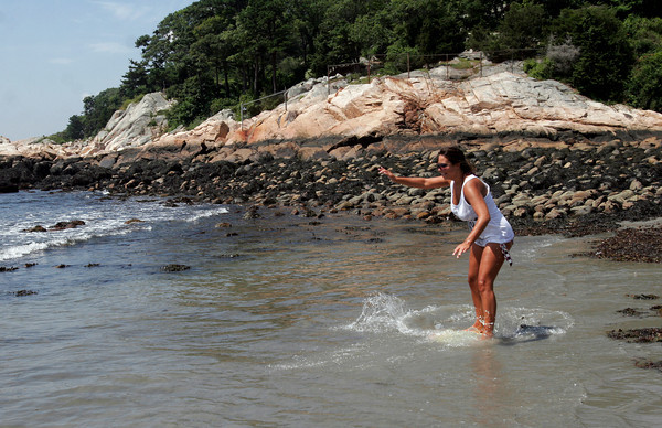 Manchester: Caitlin Wallace of Manchester learns how to skim board at White Beach in Manchester yesterday morning. Photo by Kate Glass/Gloucester Daily Times Tuesday, July 28, 2009