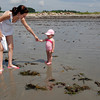 Manchester: Jessica Sullivan of North Reading leads her daughter, Marina Sullivan, 16 months, to the water at White Beach yesterday morning. It was Marina's first trip to the beach. Photo by Kate Glass/Gloucester Daily Times Tuesday, July 28, 2009