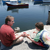 Rob Watson and son Kyle Watson of Westhampton are enjoying a lobster lunch on Bearskin Neck after a morning at the beach yesterday. They had plans to catch a Red Sox game that night. Photo by Maria Uminski/Gloucester Daily Times