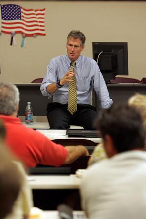 "Gloucester: Senator Scott Brown talks with former fisherman and fishing advocates at The Fish Auction Friday afternoon.  Brown made his first fact finding trip to the Gloucester fishing industry and pledged to organze ""serious"" hearings into law enforcement excesses. Mary Muckenhoupt/Gloucester Daily Times"