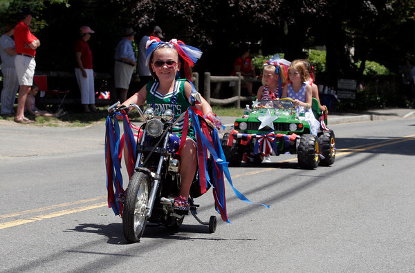 Manchester: Catherine Garlitz leads the Junior Hornets float in the Manchester 4th of July Parade yesterday afternoon. Photo by Kate Glass/Gloucester Daily Times