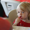 Manchester: Avery Sommerville, 2, eats all the strawberries off her plate at the annual Red, White and Blue Breakfast held at Tuck's Point Saturday moning. The menu included bacon, eggs, and pancakes with blueberries, strawberries and whipped cream. Mary Muckenhoupt/Gloucester Daily Times