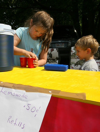 Rockport: Rachel Dailey, 7, and her brother Christopher, 3, set up a lemonade stand on King Street yesterday afternoon hoping to catch a few beachgoers on their way to and from the beach and commuter rail. Photo by Kate Glass/Gloucester Daily Times