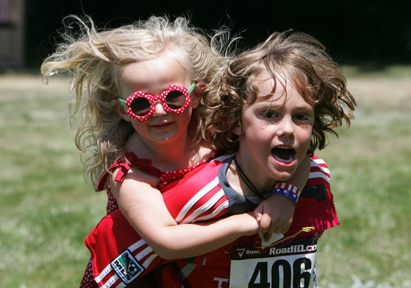Gloucester: Coel Ferguson-Sauder, 7, carries Anna Hafey, 4, of his back duirng a piggy-back race at the LEAP, Lanesville Emergency Action Program, 2010 Extravaganza at the Lanesville Community House Saturday.  The day included a 4K race, one mile frun run, and food, and family games. Mary Muckenhoupt/Gloucester Daily Times