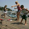 Manchester: Kathleen Lawler stands as far away as possible while her son Charlie tries to catch a crab that escaped from his trap while catching crabs with his sisetr Megan at Tucks Point Friday afternoon. Mary Muckenhoupt/Gloucester Daily Times