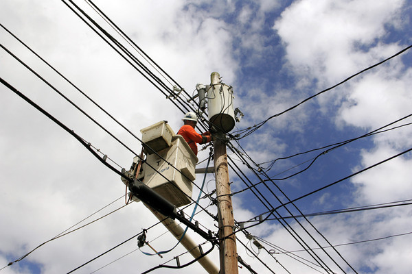 Gloucester: National Grid worker Rich Duchane of Gloucester works on connecting a secondary power line after a lost tractor trailer truck took out an old telephone pole on Washington Street Thursday afternoon. The telephone pole was not replaced instead the wire was just connected to this pole across the street from the accident which happened across the street from Creely Funeral Home. Mary Muckenhoupt/Gloucester Daily Times