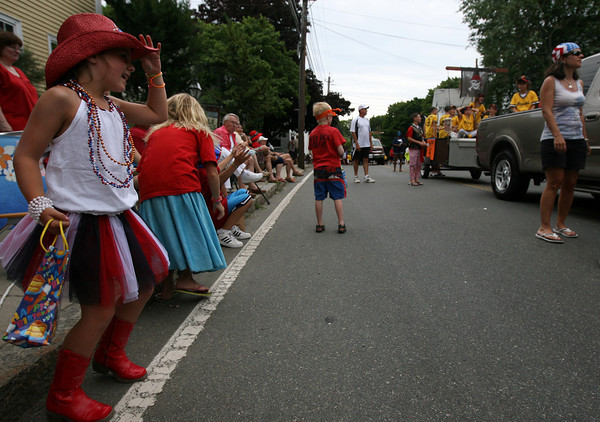 Rockport: Grace Beacham, 7, tips her hat to the Pirates baseball team while dancing during the Rockport Firemen's Parade yesterday. Photo by Kate Glass/Gloucester Daily Times
