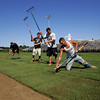 Gloucester: From left, upcoming seniors and football players Bryan Ingersoll, Josiah Bedrosian and Jordan Shairs along with Corey Frost, of Home Field Athletics work to resod Newell Stadium Friday afternoon.  The Gloucester Fisherman's Athletic Association paid to resoded the field, which hadn't been done in at least 12 years, because the condition of the field was unplayable.  Mary Muckenhoupt/Gloucester Daily Times