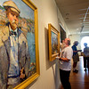 Gloucester: Facilities manager Paul Miller hangs a painting by Rockport artist Herbert Barnett for the show Art is Long, Life is short: Rockport Artists in the 1930s at the Cape Ann Museum Thursday morning. Pictured right is local art collector Bill Trayes and Cape Ann Museum Director Ronda Faloon. Pictured left a portrait of C.S. Kaelin by Agnes Richmond. Mary Muckenhoupt/Gloucester Daily Times.