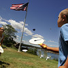 Gloucester: Maggie Desino, 11, and her brother Tucker, 7, enjoy the nice weather by playing a game of paddle ball on their front lawn of their Rocky Neck home Friday afternoon.  The kids were excited for the Forth of July cookout their parents were setting up for and being able to watch the fireworks from their lawn.  The weather forecast fror the weekend looks to be sunny with temperatures climbing into the low 90s on Sunday. Mary Muckenhoupt/Gloucester Daily Times