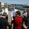Gloucester: Charlie Baker, republican candidate for governor, and Bill Hudak, left, republican candidate for congress, talk with a group of Gloucester fishermen at St. Peter's Square yesterday about how the regulations are forcing them out of work. Photo by Kate Glass/Gloucester Daily Times