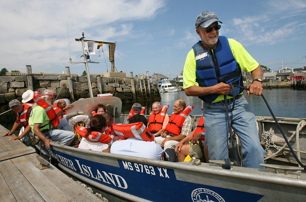 Rockport: Paul St. Germain, President of the Thacher Island Association, takes Rockport Selectmen, representatives from the General Services Administration and U.S. Coast Guard, and volunteers out to see Straitsmouth Island and Thacher Island yesterday morning following a ceremony celebrating the town's new ownership of the Straitsmouth Island lighthouse. The Thacher Island Committee will manage the lighthouse. Photo by Kate Glass/Gloucester Daily Times
