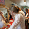 """Gloucester: Mollie Thurman puts some last touches on her wax-like makeup before the annual Wax Works show at the Annisquam Village Hall Saturday morning.  For more than 50 years the historic Wax Works show has been a sold out performance as actors pretend to be wax figures with a different theme each year.  This years theme was """"All About Time."""" Mary Muckenhoupt/Gloucester Daily Times"""