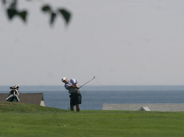 Gloucester: Ed Young fires off a shot during the Bass Rocks Golf Club Championship yesterday. Photo by Kate Glass/Gloucester Daily Times