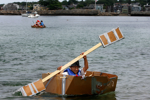 Rockport: John Maihos, deputy of the 10th district of the Grand Lodge of Massachusetts rows his cardboard boat into shore during the annual Race to the Bottom at Back Beach Saturday afternoon.  The race, put on by the Tyrian-Ashler-Acacia Lodge as a fundraiser, requires its participants to build a boat using only certain items such as cardboard, a 25 ft. rop, duct tape, and a can of schalak. Ten boats were in this years race and all but a few didn't make it. Mary Muckenhoupt/Gloucester Daily Times