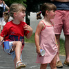 Manchester: Cali Parkins, 5, dances and waves an American flag while watching the Manchester 4th of July Parade with her sister, Emily Parkins, 4, yesterday afternoon. Photo by Kate Glass/Gloucester Daily Times