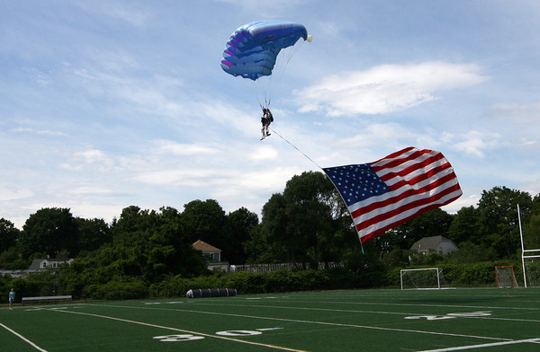 Manchester: A skydiver from Air Adventures lands on Coach Ed Field FIeld following the Manchester 4th of July Parade yesterday afternoon. Photo by Kate Glass/Gloucester Daily Times