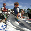 Rockport: Griffin Webber, 12, rolls up his sail after the Linda Wieditz Memorial Opti Regatta at Sandy Bay Yacht Club Friday afternoon. Pictured left is Matt Safford, 12. Mary Muckenhoupt/Gloucester Daily Times