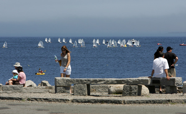 Rockport: As seen from the tip of Bearskin Neck, kids race in the Linda Wieditz Memorial Opti Regatta Friday afternoon. The regatta, out of Sandy Bay Yacht Club, is for young sailors ages 8 to 13. Mary Muckenhoupt/Gloucester Daily Times