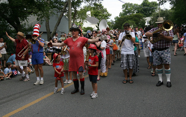 Rockport: Kera and Olyvia Ramsden accompany their grandfather, George Ramsden, as he leads the Firemen's Marching Clown Band during the Rockport Firemen's Parade yesterday. Photo by Kate Glass/Gloucester Daily Times