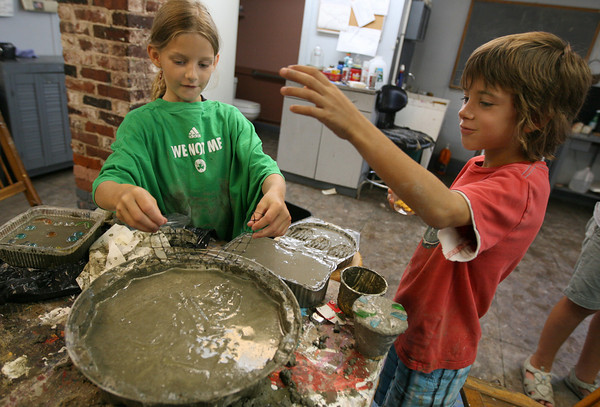 "Rockport: Annie Hendrickson and Charlie Krupka make stepping stones during ""Garden Sculpture with Kathy Hilliard"" at the Rockport Art Association on Tuesday. The class runs through the end of the week. Photo by Kate Glass/Gloucester Daily Times"