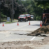 Essex: A water main on Martin Street was accidentally struck by a National Grid crew yesterday afternoon, forcing the road to be closed near Town Hall. The break caused major damage to the road. Photo by Kate Glass/Gloucester Daily Times