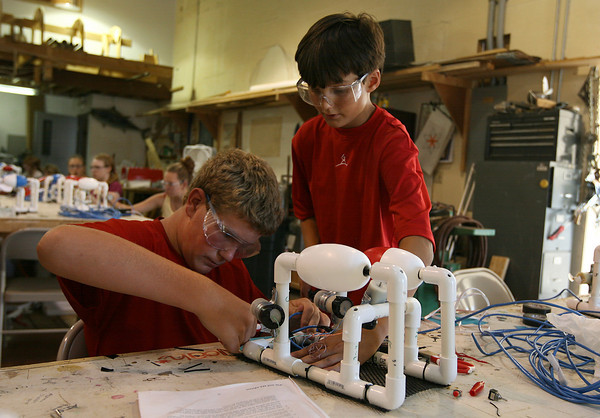 Gloucester: Nick Kenyon helps Nick Ciluffo with the wiring on his remote operated vehicle at the Gloucester Maritime Heritage Center during a two-week science camp. Photo by Kate Glass/Gloucester Daily Times