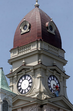 Gloucester: Tom Moore of Moore's Steeple People prepares to install new mechanical elements for the clock faces at Gloucester City Hall yesterday afternoon as part of the building's restoration. Photo by Kate Glass/Gloucester Daily Times