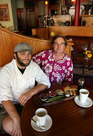 Gloucester: Ed Robinson, the new head chef at Alchemy, sits with restaurant owner Mark McDonough. Photo by Kate Glass/Gloucester Daily Times