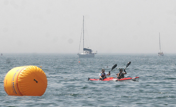 Gloucester: Gary Williams and Robin Francis paddle past the finish line of the Blackburn Challenge, a 20-mile open water race around Cape Ann, at Pavilion Beach Saturday morning. Photo by Kate Glass/Gloucester Daily Times