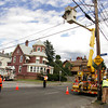 Gloucester: Auxilary police officer John Mondello stops traffic as National Grid workers connecting a secondary power line after a lost tractor trailer truck took out an old telephone pole on Washington Street Thursday afternoon. The telephone pole was not replaced instead the wire was just connected to this pole across the street from the accident which happened in front of Creely Funeral Home. Mary Muckenhoupt/Gloucester Daily Times